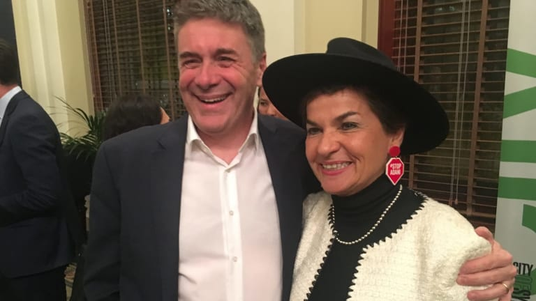 Christiana Figueres wearing Stop Adani ear rings, with Andrew Petersen, CEO of Sustainable Business Australia.