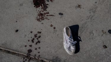 Blood and a lost shoe down the street from the Mandalay Bay Resort and Casino, in Las Vegas.