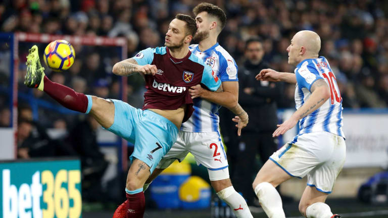 Impact man: Marko Arnautovic broke Huddersfield apart as West Ham United won 4-1.