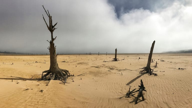 """Theewaterskloof Dam, a key source of water supply to Cape Town, South Africa, is shown at low levels in April 2017. The city announced new water restrictions Thursday, Jan 18, 2018 to combat the drought, saying it was looking more likely that it will have to turn off most taps on """"Day Zero,"""" or April 21, 2018. Mayor Patricia de Lille said 60 percent of residents are """"callously"""" using more than the current limit and that the city will fine households that use too much water."""