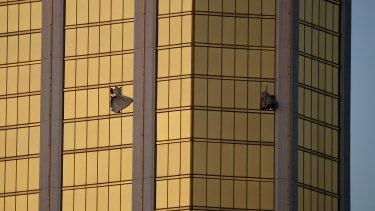 Drapes billow out of broken windows at the Mandalay Bay resort and casino following the deadly shooting.