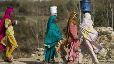 Pakistani women fetch clean water for their families.