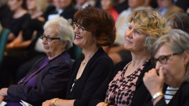 Journalist Geraldine Doogue and other mourners at the funeral for Adele Horin.