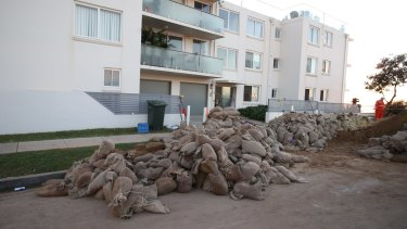 Sand bags surround Collaroy properties on Wednesday morning following another king tide that hit on Tuesday night.