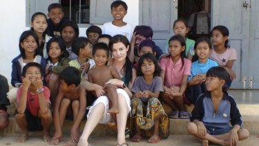 """Tara Winkler (seen here with Cambodian children in 2007) set up her own orphanage in  Battambang, in the west of the country, before turning away from centre-based care for children, which she now calls a """"trap""""."""