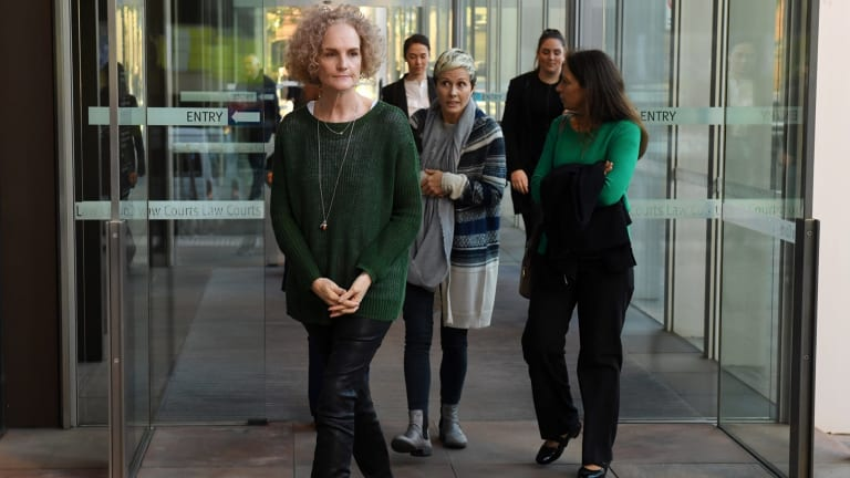 Members of the class action against Johnson & Johnson, Gai Thompson, Joanne Maninon and Carina Anderson, leave the Federal Court on Tuesday.