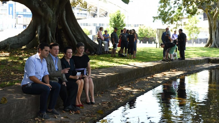 Alex Greenwich, Ron Hoenig, Clover Moore and Jenny Leong at Kippax Lake on Wednesday.
