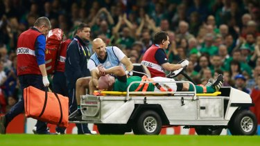 Ireland's captain, Paul O'Connell, is stretchered off against France.
