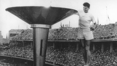 Ron Clarke lights the flame at the 1956 Melbourne Olympics.