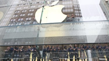 Staff at the Apple store in Sydney. Apple is one of many US multinationals that has been criticised for not paying enough tax in Australia.