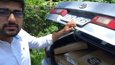 "Vocational education salesman ""Hamza""  and his car full of laptops."
