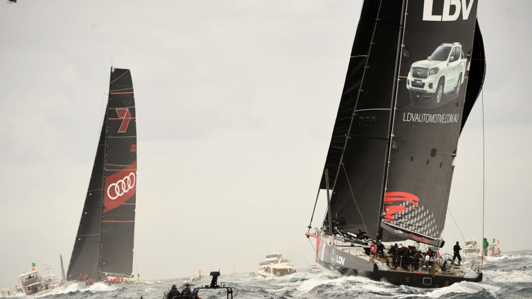 Into the lead: Comanche, right, is past Wild Oats XI and on track to break the record.