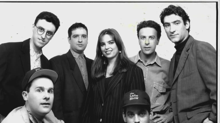 The D-Generation's The Late Show on the ABC was a huge success in the '90s. Back Row (L-R) Tony Martin, Mick Molloy, Jane Kennedy, Santo Cilauro and Jason Stephens. Front Row (L-R) Tom Gleisner and Rob Sitch.