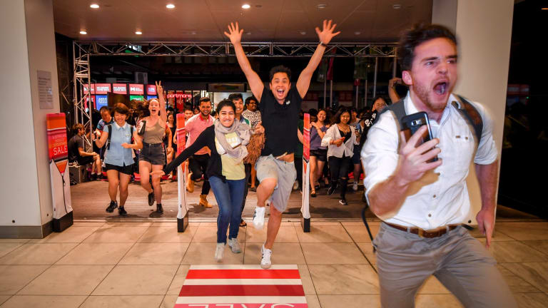 Crowds rush the doors at Myer for the Boxing Day sales last year.