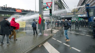 Water cannons are deployed to prevent clashes between demonstrators.