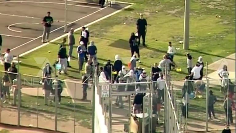 Channel 7 chopper captures images of prisoners rioting inside MRC compound on June 30.