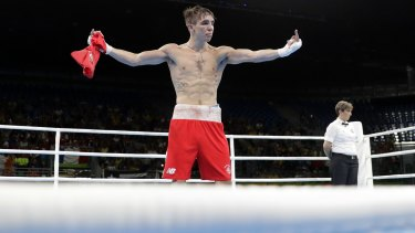 Ireland's Michael Conlan walks around with his shirt off after losing his fight.