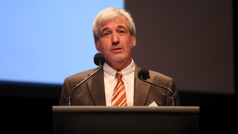 Graham Sansom said his report saw regional organisations as a genuine alternative to mergers.