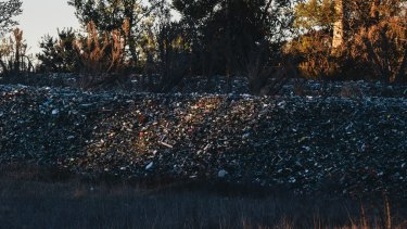The piles of glass from ACT recycling bins dumped near the Federal Highway at Lake George.