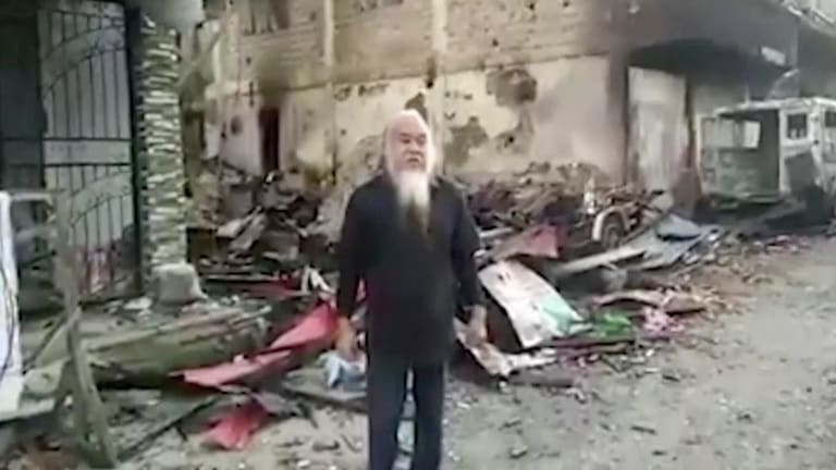 An undated militant video shows Father Teresito Suganob saying he's being held alongside 200 other captives, including children.