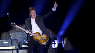 Sir Paul McCartney takes the stage for his performance at the Firefly Music Festival in Dover, Delaware on Friday night.