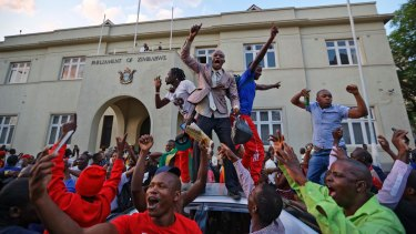 Celebrations outside the parliament building in downtown Harare, Zimbabwe after Mugabe resigned.