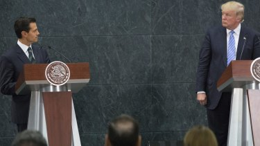 Mexican President Enrique Pena Nieto, left, looks at Donald Trump during a joint conference in Mexico City.