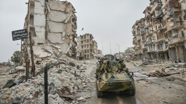 Palliate this? Russian troops in the devastated Syrian city of Aleppo.
