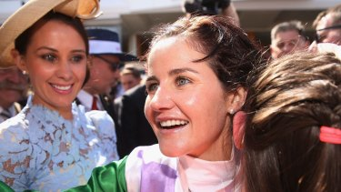 Jockey Michelle Payne and her sisters celebrate her 2015 Melbourne Cup winning ride on Prince Of Penzance.