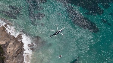 A water-bombing helicopter returns to the ocean near Lorne for a refill.