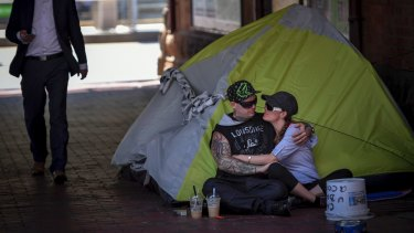 Homeless couple Josh and Tara near the corner of Flinders and Market Street.
