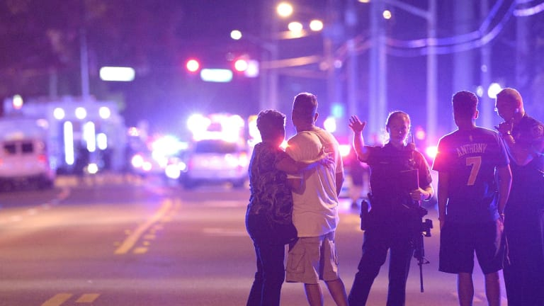 Police officers direct people away from the nightclub in Orlando, Florida,