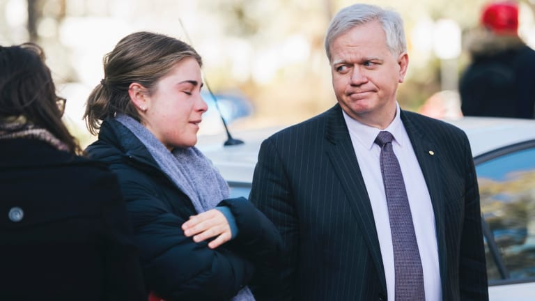 ANU vice-chancellor Brian Schmidt comforts a student during a protest held outside the university's chancellory in response to the report into sexual harassment and assault at universities.
