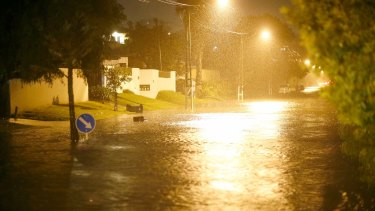 Auckland roads flood as the remnants of Cyclone Debbie moves across the country.