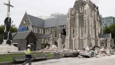 A relief worker walks past the earthquake-damaged Christchurch Cathedral in Christchurch on February 26, 2011.