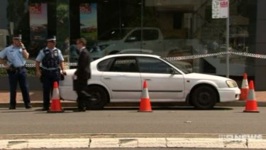 Police allege the man smashed a car's window with his axe.