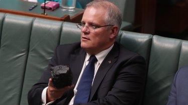 Treasurer Scott Morrison brandishing a lump of coal in Parliament.