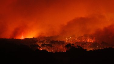 Flames sweep towards the heritage-listed NSW Central Coast town of Catherine Hill Bay on October 12, 2013.