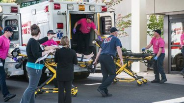 A patient is wheeled into the emergency room at Mercy Medical Centre in Roseburg, Oregon, following a deadly shooting at Umpqua Community College, in Roseburg on Thursday