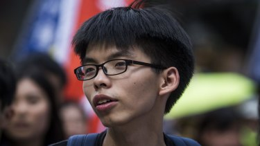 Joshua Wong, founder and convener of the student group Scholarism, marches during a pro-democracy rally in Hong Kong.