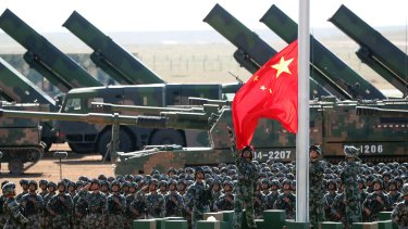 People's Liberation Army troops perform a flag-raising ceremony.