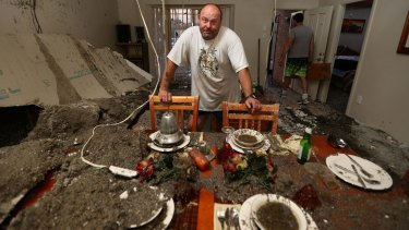 Frank Partlic stands in his ruined home at Kurnell.