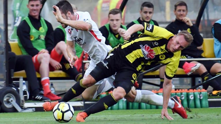 Cross-purposes: Brendan Hamill of the Wanderers and Goran Paracki of the Phoenix clash.