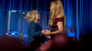 Hillary Clinton is welcomed to the stage by Laverne Cox at the LBGT For Hillary Gala in New York.