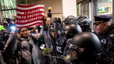 New York City Councilman Jumaane Williams, centre, joined demonstrators protesting outside JFK Airport in New York.