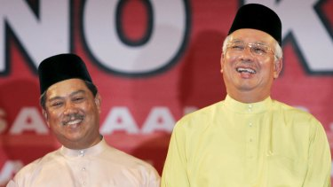 Malaysian Prime Minister Najib Razak (right) axed his deputy Muhyiddin Yassin (left).