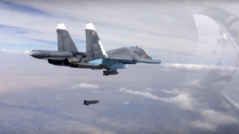 A bomb is released from a Russian Su-34 strike fighter in Syria in a video posted on Friday.