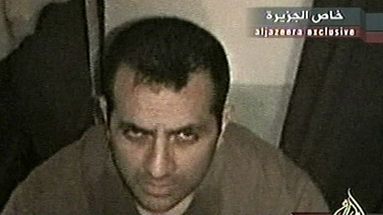 'Now you'll see how an Italian dies' ... Italian hostage Fabrizio Quattrocchi, who was kidnapped by insurgents in Iraq, is said to have pulled off his mask and confronted his captors just before he was shot. Image from Al-Jazeera TV.