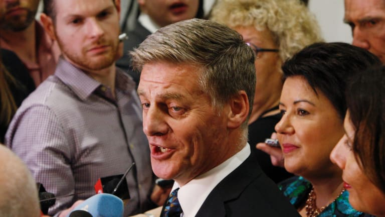 Outgoing Prime Minister Bill English talks to reporters on Thursday after learning Labour would form government.