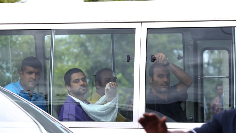 Injured asylum seekers arrive at hospital after the Manus riot.
